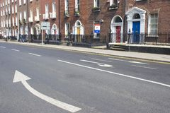 Arrow on street. Big arrows on Dubliner cross Stock Photos