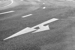 Arrow Symbol on Asphalt Road. Arrow Symbol on Asphalt Road Mandatory for direct and left Out of curves Royalty Free Stock Photo