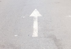 Arrow symbol on a black asphalt road surface Stock Photo