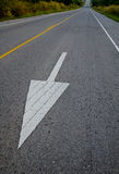 Arrow symbol traffic on the road Royalty Free Stock Images
