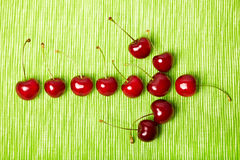 Arrow to the right made of cherries Stock Photos