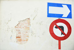 arrow traffic sign with old wall Stock Images