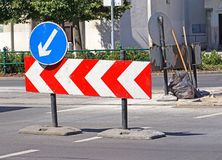 Arrow traffic signs at the road construction in the city Royalty Free Stock Photography