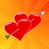 Arrow through two hearts Royalty Free Stock Photography