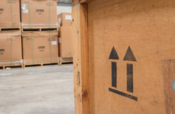 Arrow up icon on wooden board  in warehouse Stock Photography