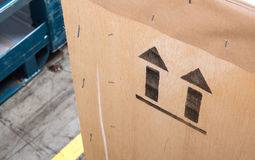 Arrow up icon on wooden board in the warehouse Stock Image