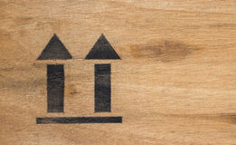 Arrow up icon on wooden in the warehouse Stock Image