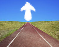 Arrow up shape cloud in blue sky with running track Royalty Free Stock Photo