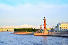 Arrow of Vasilevsky island and Rostral columns at sunset. In Saint-Petersburg. St. Petersburg Stock Images