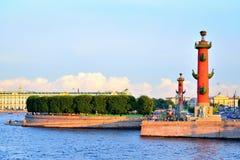 Arrow of Vasilevsky island and Rostral columns under blue sky at. Sunset in Saint-Petersburg. St. Petersburg Stock Images