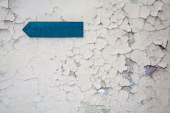 Arrow on the wall. Arrow pointer on the wall with cracks royalty free stock images