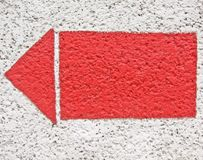 Arrow on the wall. Red arrow on the white wall stock images