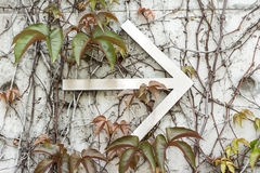 Arrow on the wall Royalty Free Stock Photography