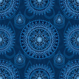 Arrow weapon mandala seamless pattern. This illustration is design and drawing abstract arrow weapon with circle mandala in blue color background and seamless Stock Photo
