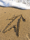 Arrow on wet sea sand Stock Photos