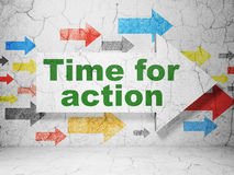 Arrow whis Time for Action on wall background Stock Photo