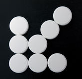 Arrow of white tablets Stock Photos