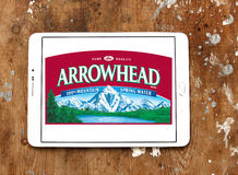 Arrowhead brand mountain spring water logo. Logo of arrowhead mineral water company on samsung tablet on wooden background stock photos