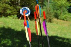 Arrows. With target blurred in background Stock Images