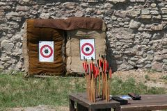 Arrows against the target Stock Photos