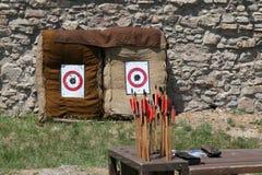 Arrows against the target Stock Photos