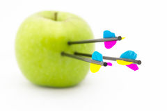 Arrows on apple Royalty Free Stock Images