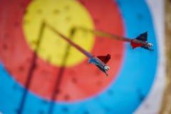 Arrows in archery target. On archery range Royalty Free Stock Photos