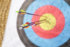 Arrows in archery target. On archery range Stock Photography