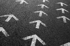 Arrows on Asphalt Royalty Free Stock Photos