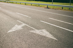 Arrows on asphalt Stock Photography