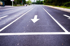 Arrows on the asphalt to indicate the direction of driving Stock Image