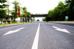 Arrows on the asphalt to indicate the direction of driving Royalty Free Stock Image