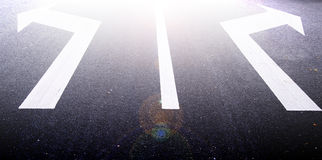 Arrows on the asphalt to indicate the direction of driving Royalty Free Stock Images
