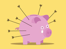 Arrows attack piggy bank. business risk concept. Stock Photo