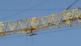 Arrows of building tower cranes against the blue sky. stock footage