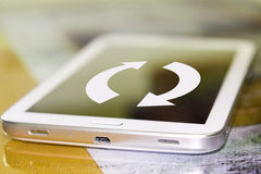 The arrows on the cell phone screen . The concept of updating web pages Royalty Free Stock Photography