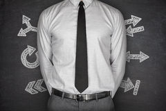 Arrows concept with businessman on Blackboard Royalty Free Stock Photography
