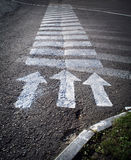 Arrows on the crosswalk Royalty Free Stock Photos