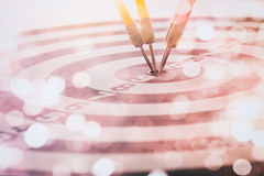 Arrows on dart board with bokeh background mean the goal and success. Suitable for all artwork design about marketing target and. Business which want to relate stock photography
