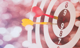 Arrows on dart board with bokeh background mean the goal and suc Stock Photos