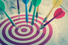 Arrows dart hitting the center of a target, success business con Stock Image