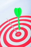 Arrows dart hitting the center of a target Royalty Free Stock Photography