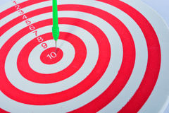 Arrows dart hitting the center of a target Stock Images