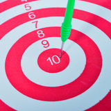 Arrows dart hitting the center of a target Royalty Free Stock Images