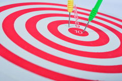 Arrows dart hitting the center of a target Stock Photos