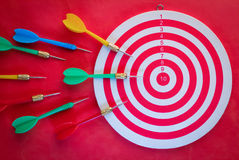 Arrows dart hitting the center of a target view from top Royalty Free Stock Photos