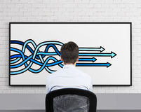 Arrows drawing on desk Royalty Free Stock Image