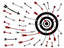 Arrows flying into bullseye Stock Photo