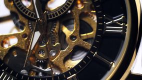 The arrows on the gold watch. Full HD stock video