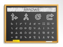 Arrows hand drawing line icons. chalk sketch signs illustration on blackboard Royalty Free Stock Photography
